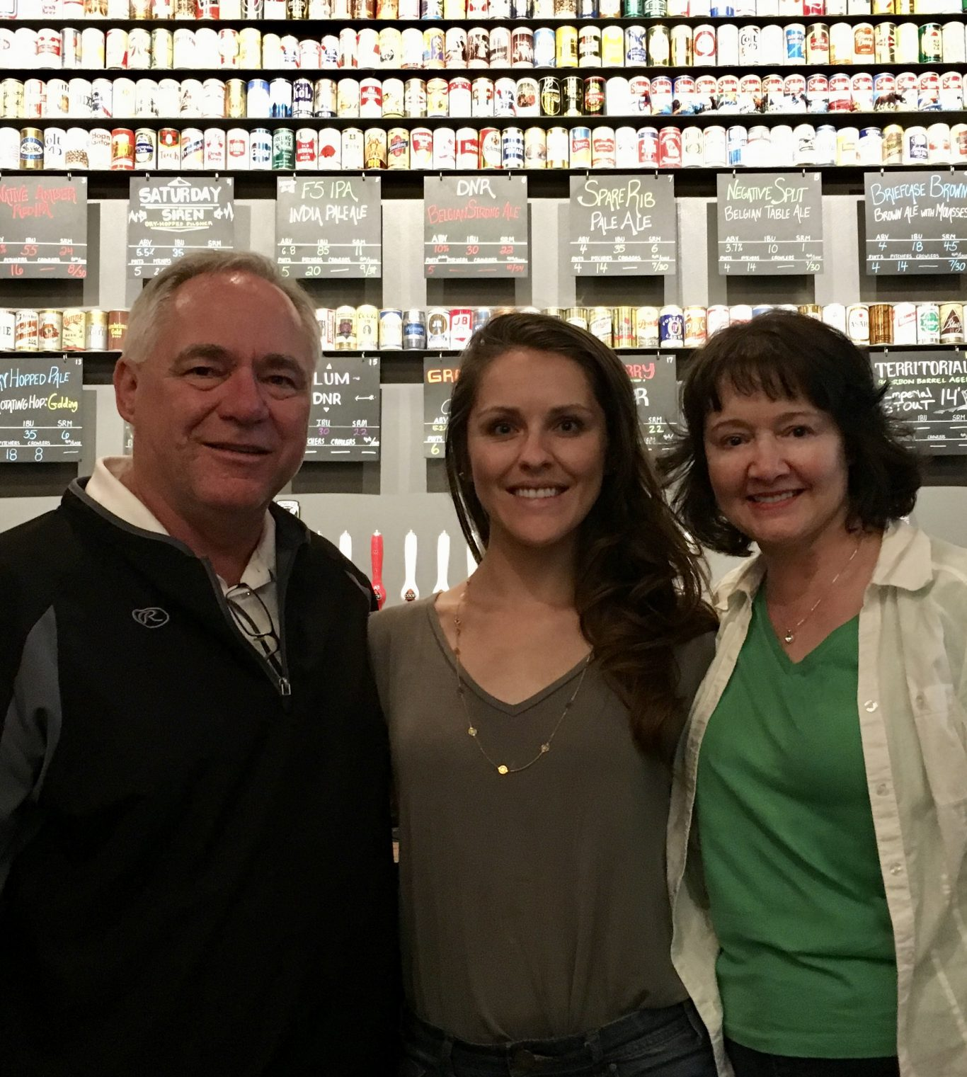 Lauren and her parents at COOP Ale Works